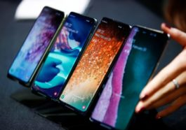 A Samsung Employee Arranges The New Samsung Galaxy S10e, S10, S10+ And The Samsung Galaxy S10 5G Smartphones At A Press Event In London